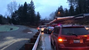 Cellphone video shows derailed Amtrak train hanging over Interstate 5 in Washington state