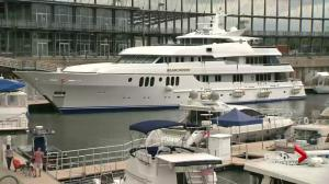 Luxury yacht docks at Montreal's Old Port