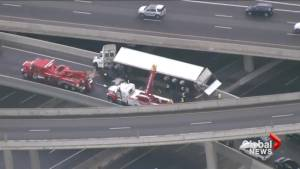 Tractor-trailer rollover causes shutdown on Highway 401
