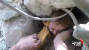 Crying child pulled alive from the rubble following alleged airstrike near Damascus