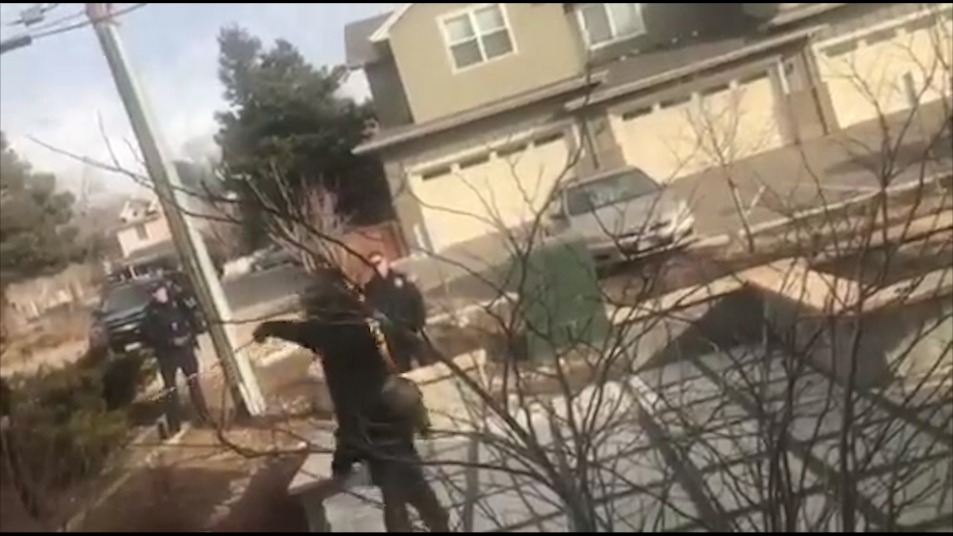 U.S. police detain black man picking up rubbish outside home