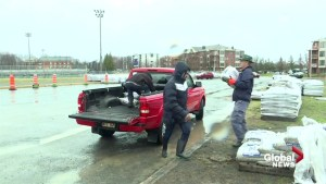Volunteers fill thousands of sandbags to save Pierrefonds homes from flooding