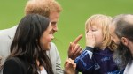 Prince Harry jokingly tells off Irish boy who played with Meghan Markle's hair