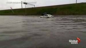 Heavy rains cause mall parking lot to flood in Kitchener, Ontario