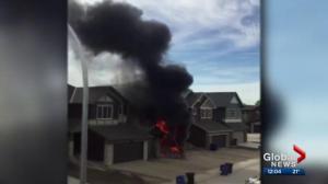 Calgary firefighters extinguish garage fire in Saddle Ridge