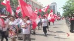 Montrealers brave the heat to take in Canada Day Parade