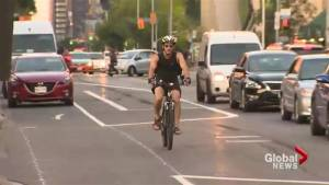 Bloor bike lanes in use but some cars blocking cyclists (01:21)