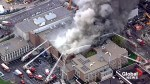 Aerial footage of scene as firefighters battle second fire at Toronto high school