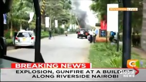 Local news station in Kenya reports live as gunshots ring out in upscale complex in Nairobi