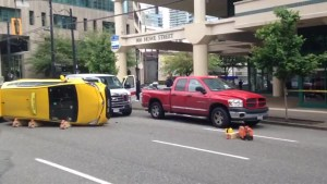 Taxi rolls over in downtown Vancouver after collision with van