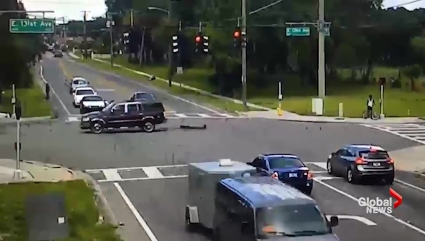 Video shows man pick up woman who fell from moving SUV