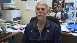 Queen's basketball coach Dave Wilson retires