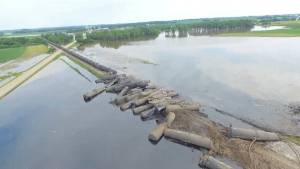 Freight train derails in Iowa spilling crude oil into flood waters