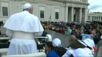Pope treats migrant children to a ride on his popemobile