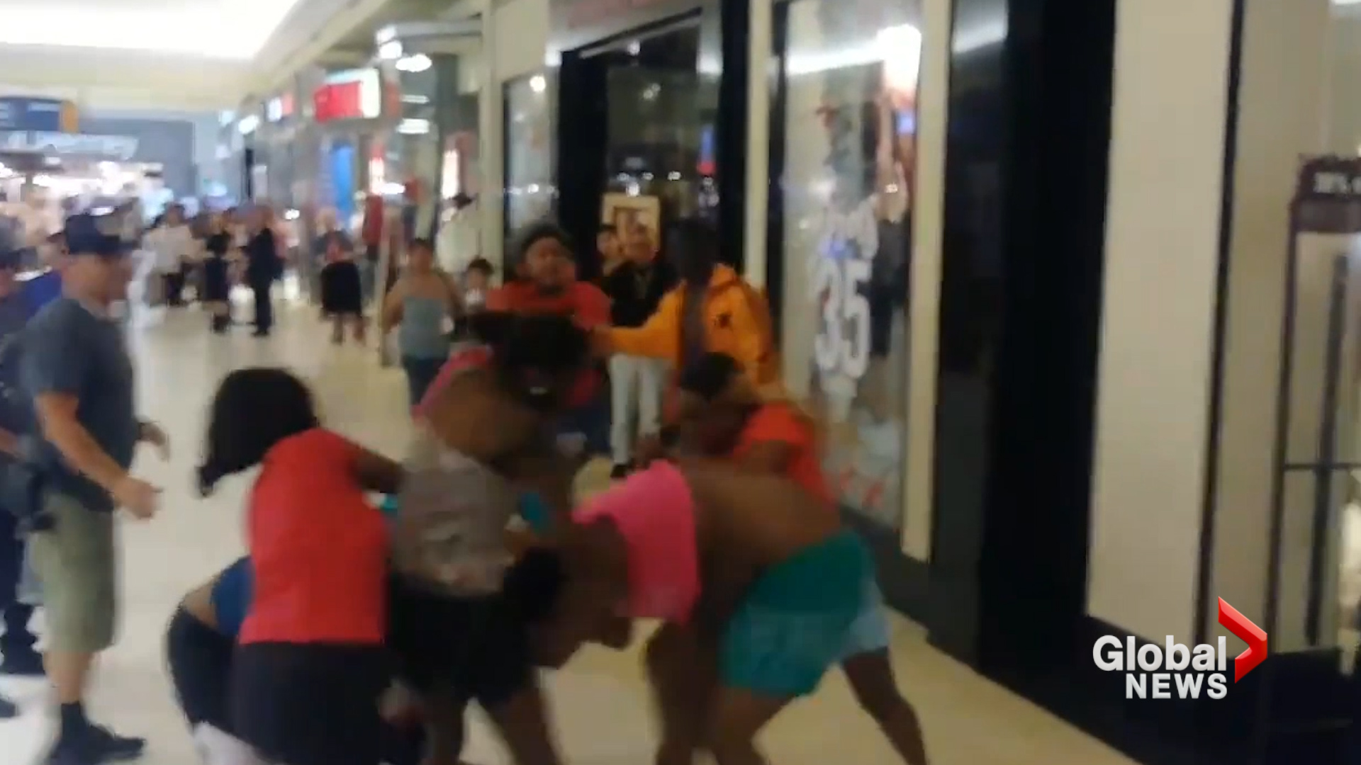 Child in stroller caught in middle of chaotic mall fight