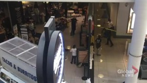 Employees at Toronto Eaton Centre deal with flooding