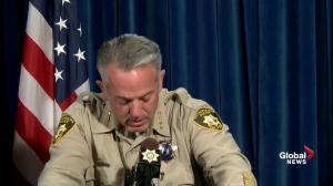 Las Vegas sheriff fights back tears describing his officer's actions