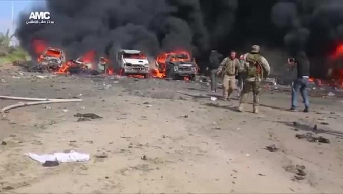 Bomb blast on bus convoy kills at least 100 in Syria