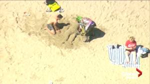 Bizarre car chase ends with 'Joker' helping bury stranger in sand on Venice Beach