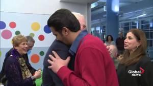 Gov. Gen. David Johnston greeted with hug by Syrian refugee