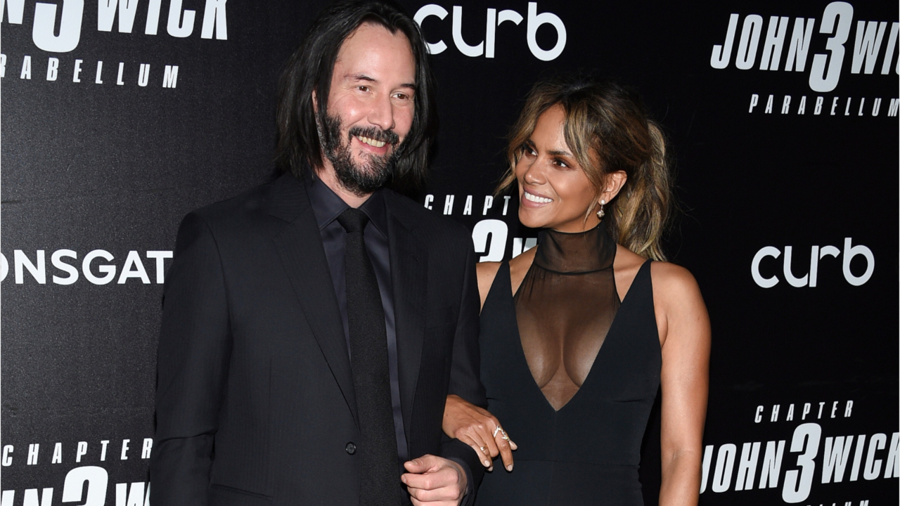 Why These Photos of Keanu Reeves Posing with Women Are Going Viral