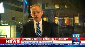 Police storm Sydney cafe after sniper reports 'Hostage down'