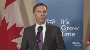 Morneau vows oilpatch support through Trans Mountain as protesters rally in Calgary
