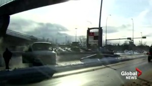 Dramatic dash cam video captures suspect fleeing from Calgary police