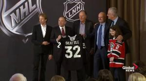 Jerry Bruckheimer presents Gary Bettman with Seattle jersey