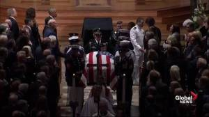 John McCain funeral: Senator's casket is carried out of Washington National Cathedral