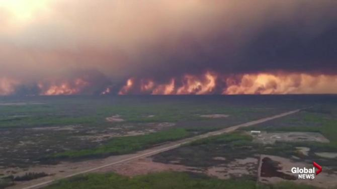 IN PHOTOS: Premier Kenney takes aerial tour of High Level wildfire