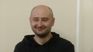 Russian journalist, reported murdered, shows up at news conference, thanks mourners