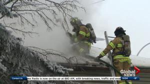 Firefighters battle house fire in north Edmonton