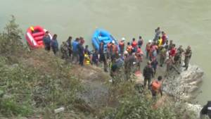 Rescuers search for survivors after bus plunges into river in Nepal