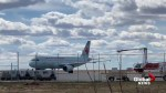 Emergency crews inspect Air Canada flight on Regina airport tarmac