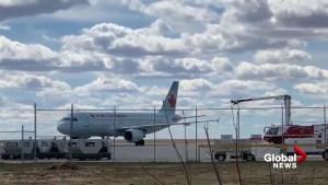 Emergency crews inspect Air Canada flight on Regina airport tarmac