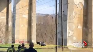 Emergency workers drop car suspended from Toronto bridge