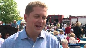 Conservative Leader Andrew Scheer mingles with potential voters at K-Days in Edmonton