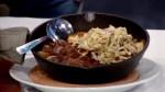 Gary Cork from the Tir Nan Og Irish pub showcases a menu staple, the Guinness Steak & Mushroom Skillet