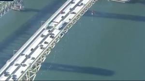 Pipeline protesters rappel from Ironworkers Memorial Bridge