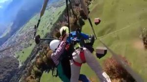 Mistake leaves tourist flying hang glider hanging on for dear life