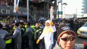 Jackie Chan carries Olympic Torch