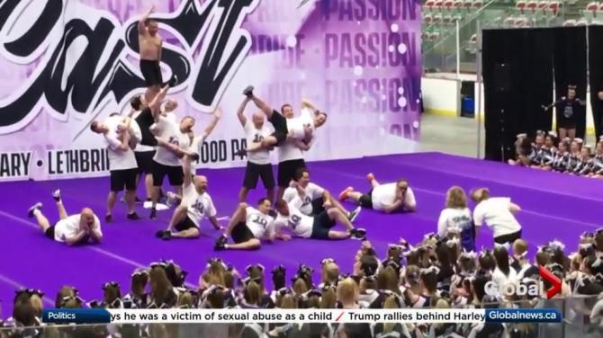 Dads surprise cheerleading daughters with their own cheer routine