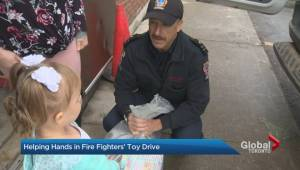 Global helps sort toys for annual Toronto firefighters' toy drive