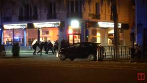 Paris police exchanging fire with attacker caught on camera