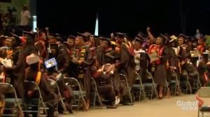 University students turn their backs on Betsy DeVos during graduation ceremony