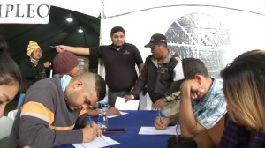 Migrants from caravan register in Mexico to work instead of risking rejection at U.S. border