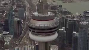 Areas below CN Tower remain closed due to concerns over falling ice