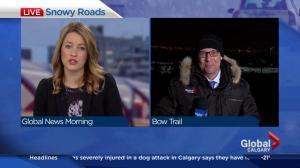 Snowy roads slow Monday morning commute