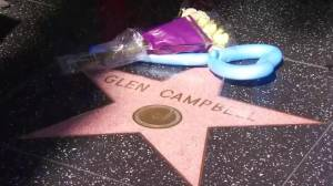 Passers-by stop to pay respects to music legend Glen Campbell